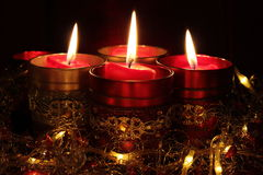 Christmas candles. A group of burning candles in decorative Stock Images