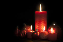 Christmas candles. And balls on black background Royalty Free Stock Images