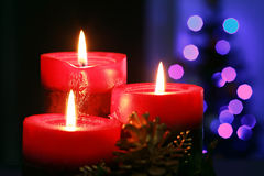 Christmas candles. With blurry lights on background Royalty Free Stock Images