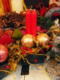 Christmas candles. Two red christmas candles with christmas decoration Royalty Free Stock Photo