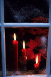 Christmas Candles. Candles sitting in a window on christmas Royalty Free Stock Photography