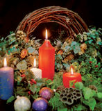 Christmas candles. Decorations, holly, and wreath. Sharp in the centre and blurred around the edges stock photography