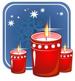 Christmas candles. Red stylized christmas candles on a  blue background Stock Image