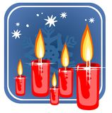 Christmas candles. Red stylized christmas candles on a  blue background Royalty Free Stock Images