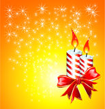 Christmas Candles. Christmas Candled and Ribbon baclground Stock Image