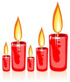 Christmas candles. Red stylized christmas candles isolated on a  white background Stock Photos