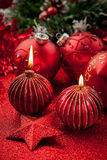 Christmas candles and balls in red Stock Images