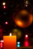 Christmas candles and baubles on dark Royalty Free Stock Photo