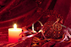 Christmas candles and baubles on red Royalty Free Stock Photos