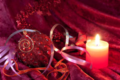 Christmas candles and baubles on red Stock Photos