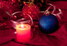 Christmas candles and baubles on red Stock Photography