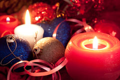Christmas candles and baubles on red Stock Images