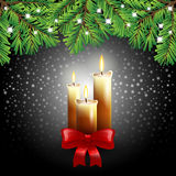 Christmas candles on black background Royalty Free Stock Image