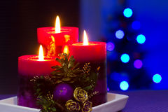 Christmas candles with blurry lights. On background Stock Photography