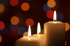 Christmas candles, with bokeh spot lights. In the background stock image