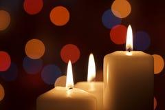 Christmas candles, with bokeh spot lights Stock Image