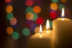 Christmas candles, with bokeh spot lights Stock Photos