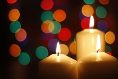 Christmas candles, with bokeh spot lights. In the background stock photo