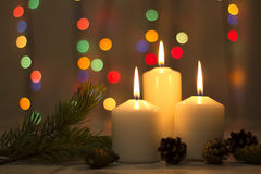Christmas candles, with bokeh spot lights. In the background stock photos