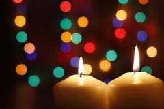 Christmas candles, with bokeh spot lights. In the background stock photography