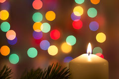 Christmas candles, with bokeh spot lights. In the background royalty free stock photo