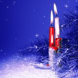 Christmas Candles Burning. In Pine Tree and Snow Stock Photos