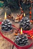 Christmas candles burning Stock Photos