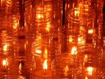 Christmas candles burning at night. Abstract candles background. Golden light of candle flame. Stock Photography