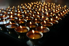 Christmas candles burning at night. Abstract candles background. Golden light of candle flame. Royalty Free Stock Photography
