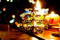 Christmas candles. And a candle holder in form of a Christmas tree royalty free stock photos