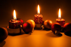 Christmas candles - Candles light. Candles and christmas balls on dark background Stock Photography