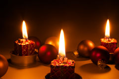Christmas candles - Candles light. Candles and christmas balls on dark background Royalty Free Stock Image