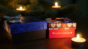 Christmas candles. Christmas and New Year. Decoration with a lit candle and beautiful colorful ornaments with blurred background, video clip stock video