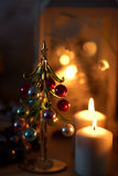 Christmas candles and the Christmas tree Royalty Free Stock Image
