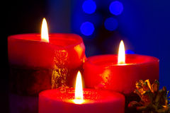 Christmas candles close up. Christmas candles with blurry lights on background Stock Photography