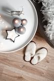 Christmas candles and decor in the cozy home interior. Christmas candles and decor in the home interior. gray interior shades stock photos