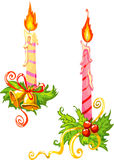Christmas candles with decor vector illustration. Vector illustration of stripy Christmas candles with decorative gold bells, red ribbons and green mistletoe on Royalty Free Stock Images