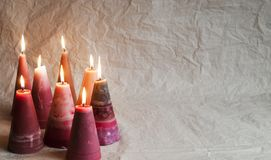 Christmas candles. Decoration on  crumpled paper background. Christmas candles. Decoration on crumpled paper background for christmas and new year Royalty Free Stock Images