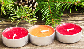 Christmas Candles Decoration and Fir Tree Stock Photo