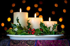 Christmas candles decoration with holly and berries. Stock Images