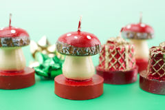 Christmas candles. Different candles on green background Royalty Free Stock Images