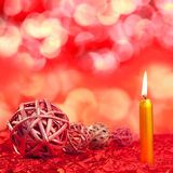 Christmas candles with dried baubles on red Stock Photography
