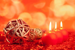 Christmas candles with dried baubles on red Royalty Free Stock Image