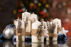 Christmas candles with dry lavender on glass table Stock Photography