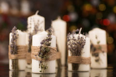 Christmas candles with dry lavender on glass table Stock Photo