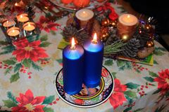 Christmas candles on the festive table on December. Royalty Free Stock Photos