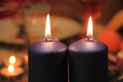 Christmas candles on the festive table on December. Royalty Free Stock Photography