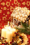 Christmas candles and gingerbread house Stock Photo