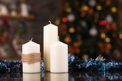 Christmas candles on a glass table Royalty Free Stock Photo