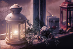 Christmas - candles glow in the steamy window stock photo